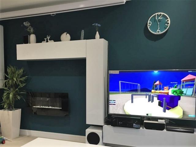 Teal lounge interior designer